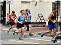 SJ9594 : Hyde 7 Road Race: Runners passing Vernon Street by Gerald England