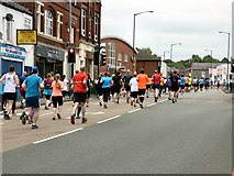 SJ9594 : Hyde 7 Road Race: Runners at the top of Market Street by Gerald England