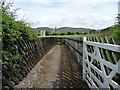 NY7515 : Gated footpath, Warcop Station by Christine Johnstone