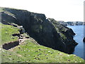 HU3529 : Cliffs on the west side of Kettla Ness by David Purchase
