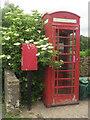 NY0634 : Telephone box, Harker Marsh by Graham Robson