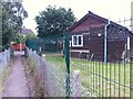 SZ0696 : Kinson: footpath E21 passes the Scout hut by Chris Downer