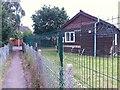 SZ0696 : Kinson: footpath E21 passes the Scout hut by Chris Downer