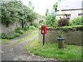 NT9932 : Elizabeth II postbox, Doddington by JThomas