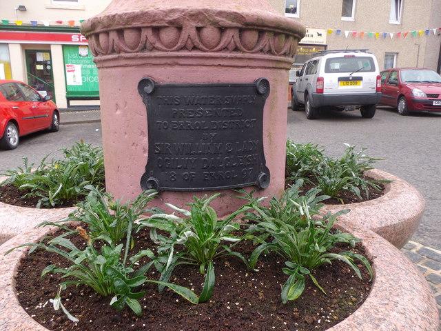 Inscription on plaque at base of Errol mercat cross