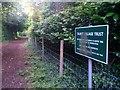 SZ0793 : Talbot Village: Village Trust sign on footpath N12 by Chris Downer