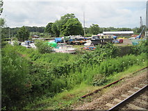 TG2608 : View from a Norwich-Great Yarmouth train - boat yard alongside river Yare by Nigel Thompson
