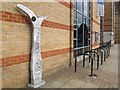 TL1999 : Cycle route marker and stands outside Peterborough library by Stephen Craven