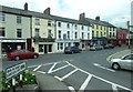 J0407 : A parade of shops on Bridge Street, Dundalk by Eric Jones