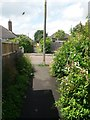 SZ0696 : West Howe: footpaths E15 and E16 arrive on Woodfield Road by Chris Downer