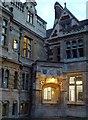 TL4458 : Evening lights in a quiet courtyard by Richard Humphrey