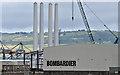 J3677 : Wind turbine masts, Belfast harbour  - July 2016(1) by Albert Bridge