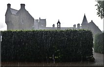 NJ1736 : Ballindalloch Castle and Gardens: The castle during a torrential downpour by Michael Garlick