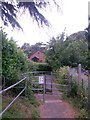 SZ0695 : West Howe: kissing gate on footpath E56 by Chris Downer