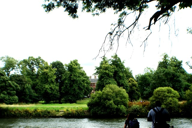 View of Ham House peeping through the trees from the Thames by Marble Hill Park