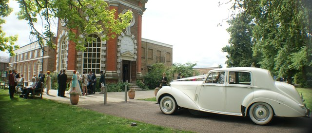 View of Marble Hill House and the 1951 Mark 6 Bentley parked up for a wedding