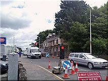 NG6423 : Building demolition, traffic jam by Richard Dorrell