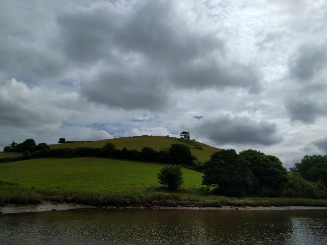 Hill on the east side of the river Dart, with the outline of a ruined building on the skyline