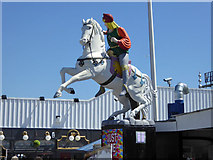 TQ3103 : White horse and male rider, Brighton Palace Pier by Robin Webster
