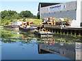 TQ2182 : Old Oak Wharf, barge loading  by David Hawgood