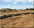 TG1615 : Drainage pipes lined up ready for use by Evelyn Simak