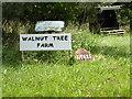 TM0480 : Walnut Tree Farm & Nutiles signs by Adrian Cable