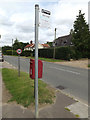 TM0383 : Bus Stop sign off The Street by Adrian Cable