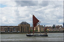 TQ3680 : View of the sail of a Thames Barge lining up with the Shard at Canary Riverside by Robert Lamb