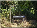TM0580 : Silver Street sign & footpath sign by Adrian Cable