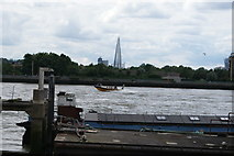 TQ3680 : View of a Thames Rib Experience boat speeding past the Shard from Canary Riverside by Robert Lamb