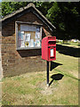 TM0074 : Post Office The Street Postbox & Notice Board by Adrian Cable
