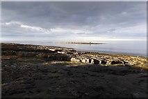 NU2520 : Rocks next to Craster Harbour by DS Pugh