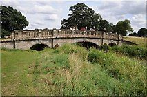 SP2556 : Bridge crossing the River Dene by Philip Halling