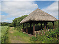 SE2336 : Thatched shelter at Rodley nature reserve by Stephen Craven