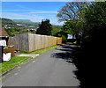 SS7798 : Long wooden fence,  Dolcoed Terrace, Tonna by Jaggery