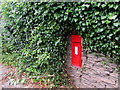 SO5015 : Victorian postbox in an ivy-clad Hereford Road wall, Monmouth by Jaggery
