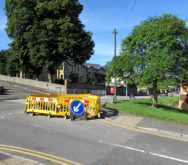 Yellow temporary barriers and green trees, Malpas, Newport