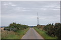 NJ9828 : Rural road with communications tower by Bill Harrison
