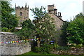SK2176 : Cottages and church tower, Eyam by David Martin