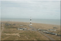 TR0916 : View of the modern Dungeness Lighthouse through a window of the Old Dungeness Lighthouse by Robert Lamb