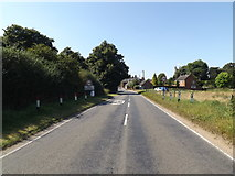 TM0890 : Entering New Buckenham on the B1113 Norwich Road by Adrian Cable