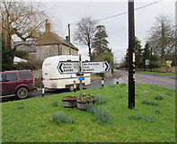 ST6976 : B4465 distances and directions signs on a grass triangle, Pucklechurch by Jaggery