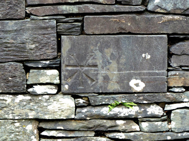 This benchmark is on Skelwith Bridge