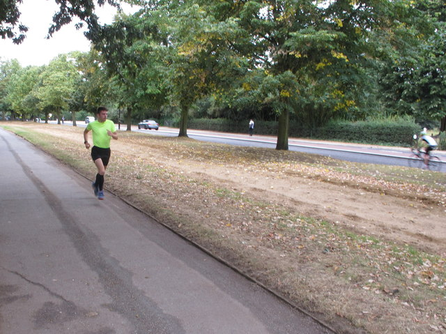 Runner beside horse, cycle and vehicle routes, Hyde Park