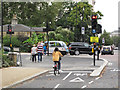 TQ2679 : Cycle and pedestrian traffic lights on cycle superhighway, Hyde Park by David Hawgood