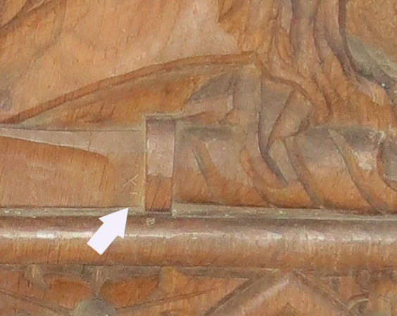 Detail of carved knife showing IXL feature