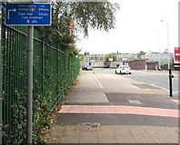 SJ8989 : Cycle route direction and distances sign, Shaw Heath, Stockport by Jaggery