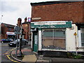 SJ8989 : Derelict shop on a Stockport corner by Jaggery