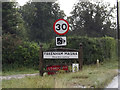 TL9077 : Fakenham Magna Village Name sign by Adrian Cable