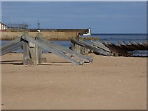NJ2370 : Remains of a breakwater by Oliver Dixon